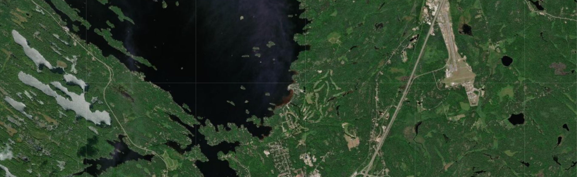 an aerial view of muskoka showing water and land