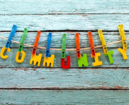 "A clothes line has the word ""Community"" pegged to it"