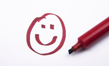 A happy face drawn with a marker