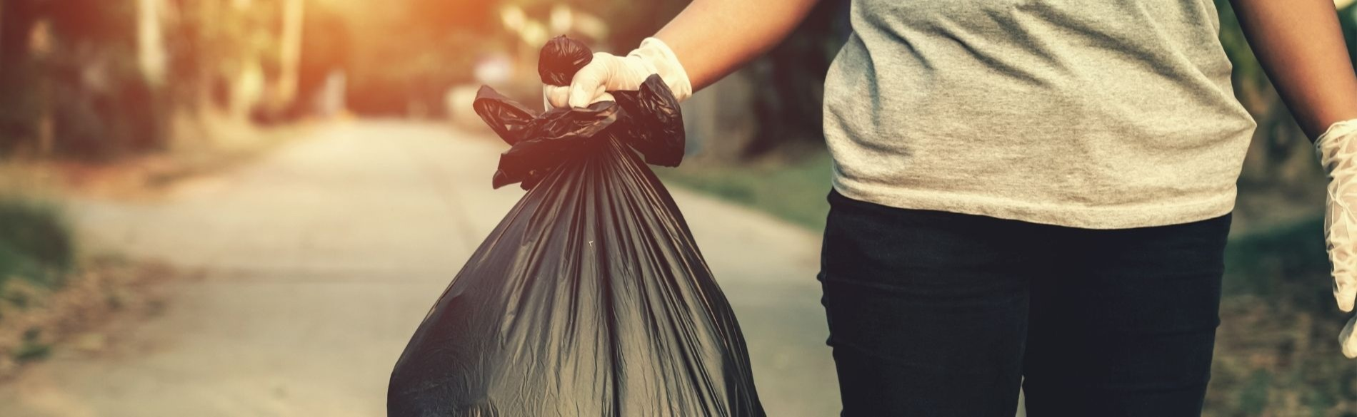 person holding a bag of garbage