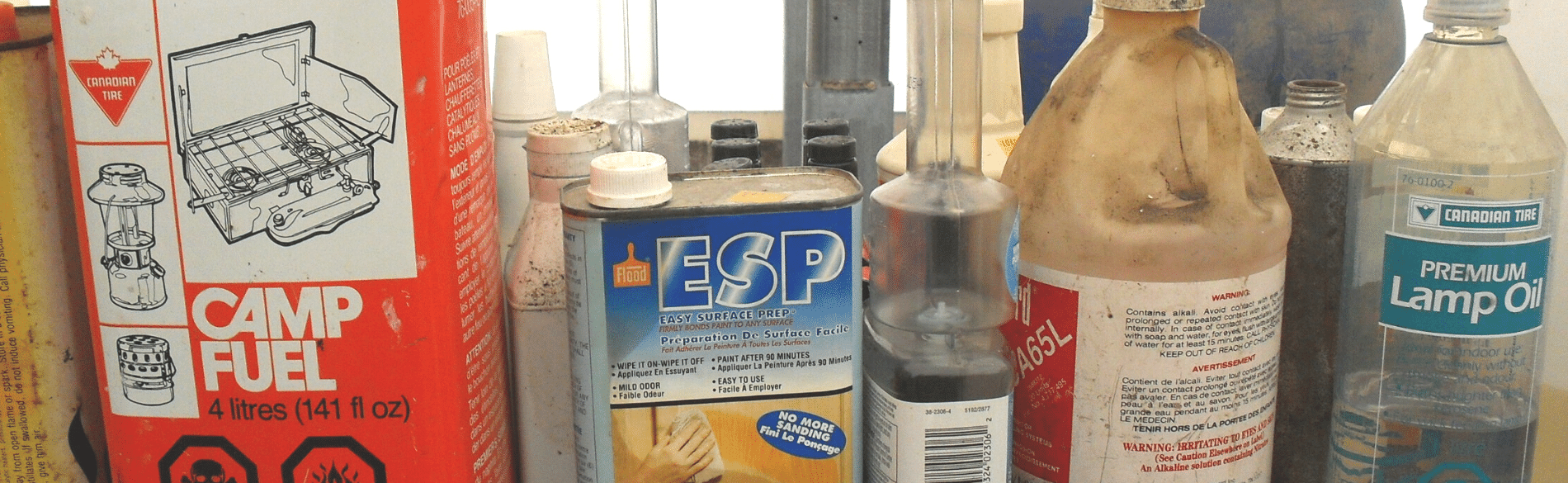 hazardous waste bottles with cleaners and camp fuel