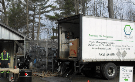 mobile collection event with a truck and worker managing household hazardous waste
